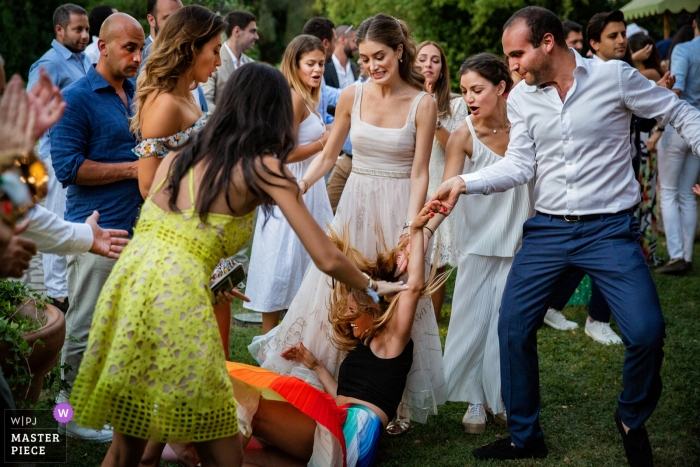 Appia Antica Wedding Venue Photos - A guest falls to the ground while dancing