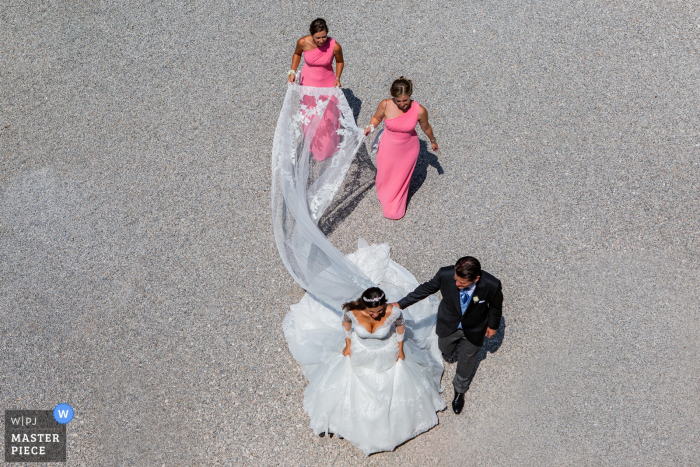 Isola del Garda - Wedding Day Photography - The couple with the the bride mates