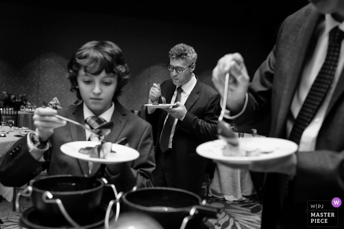 Ritz Carlton at Northstar, Truckee, CA Photography from Wedding Reception - A father & his sons enjoy fondue.