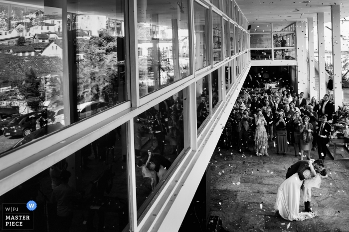 Grande Hotel Wedding Reception shot from above of the bride and groom dipping and kissing