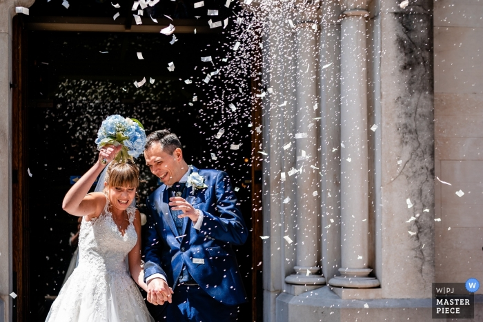 Trieste Rice and confetti toss after the church ceremony - Wedding Photojournalism