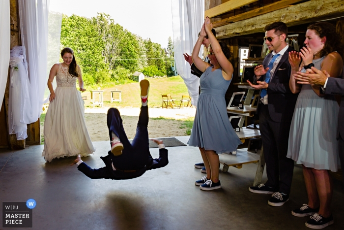Kitz Farm in Strafford New Hampshire Wedding Photographs - The groom does an impromptu flip into the wedding reception