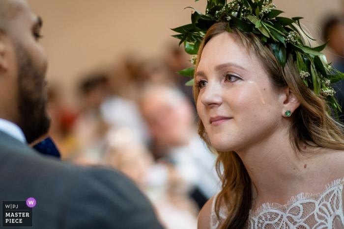Upstairs Atlanta GA Wedding Photos - Bride sheds a tear during vows