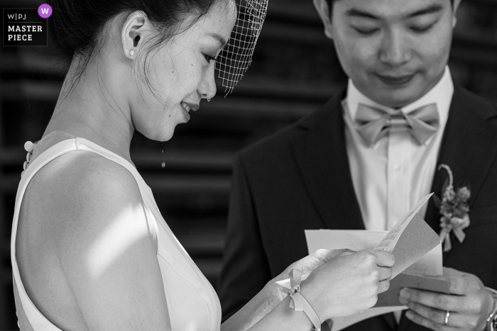 Beijing bride cries as she reads a letter with her groom on wedding day..