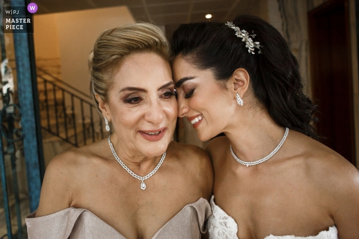 Wedding day photograph of a bride saying goodbye to her mother as she leaves her home and heads to Beirut, Sursock Palace.