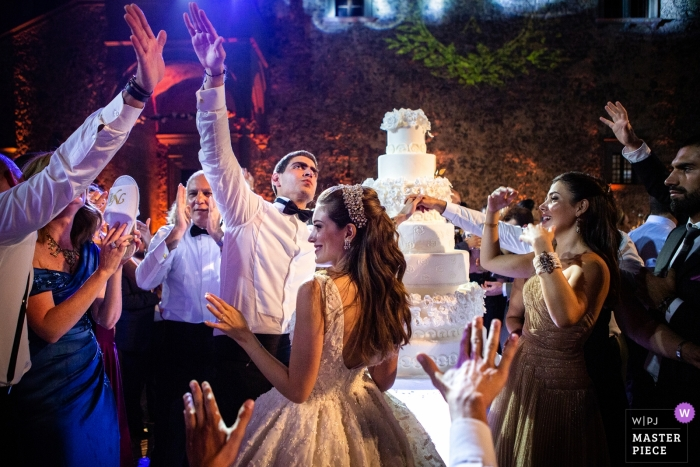 Castello Odescalchi Wedding Photography - Dancing after the cut of the cake