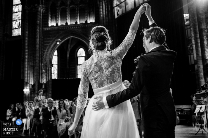 Vondelkerk Amsterdam wedding photo of the bride and groom - - expression during ceremony