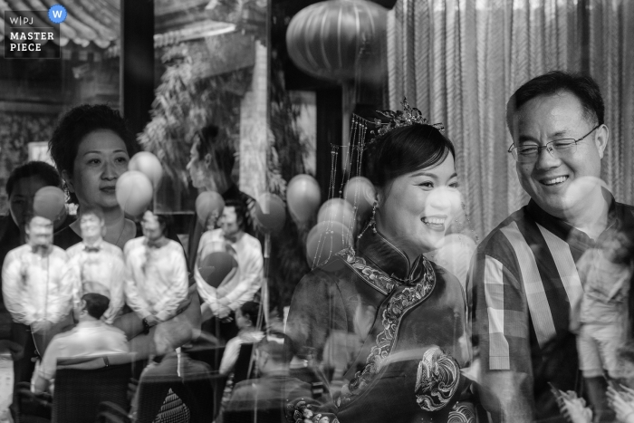 Beijing China black and white actual day wedding photos of the bride.