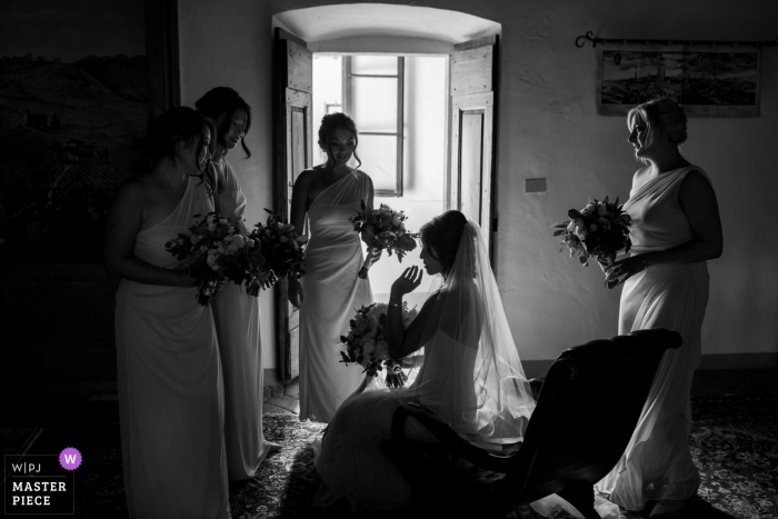 Castello di Meleto wedding photo of the bride and her bridesmaids awaiting the ceremony.