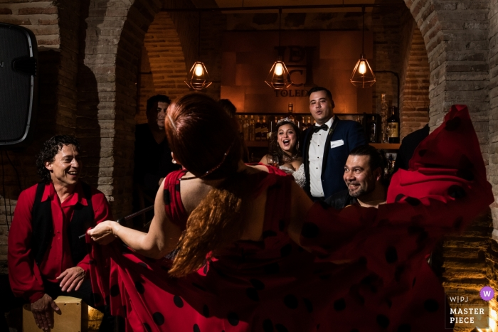 Spain Wedding Reception Photography - Bride and groom looking to a private flamenco spanish dance show