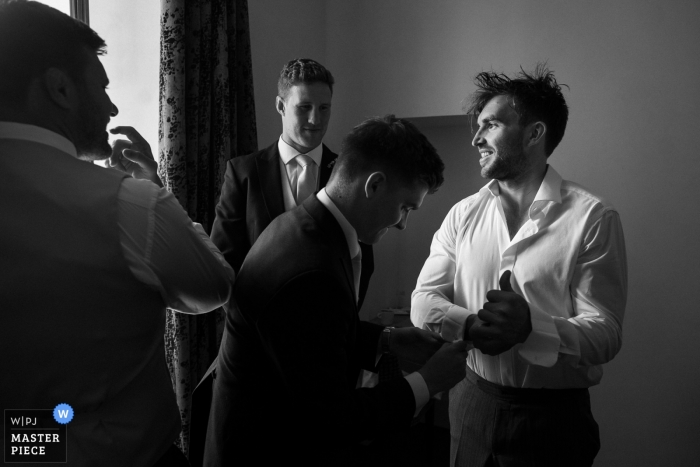 Abbaye de Talloires, Annecy France Wedding Photojournalism | Groom and friends are getting ready