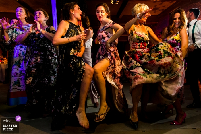 Wedding guests dance at the reception of a Loft Leuven wedding venue event.