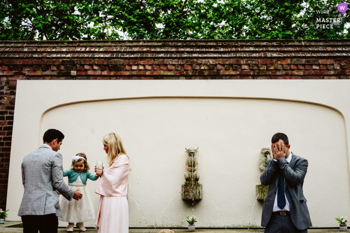 Arley Hall, Cheshire Wedding Reportage Photography of guests playing hide and seek