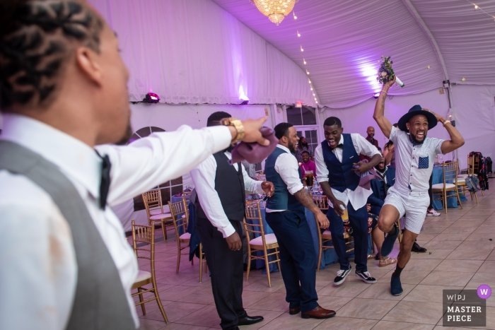 Maryland reception venue photography - A man caught the bouquet at the wedding party