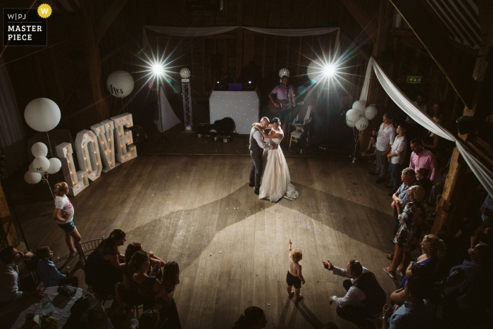 Tewin Bury Farm Hotel, UK Wedding Reportage Photo | Little Kid spotted his parents dancing for the first time as Husband and Wife - Chesham Wedding Photographer