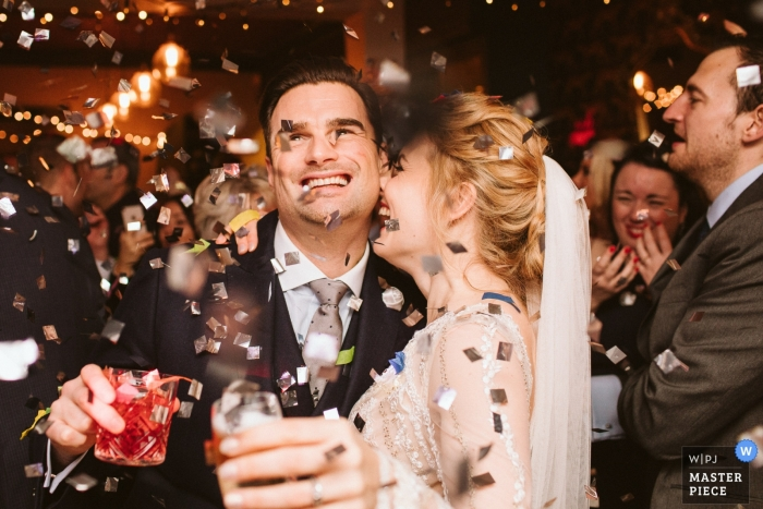 Chesham Wedding Photography showing the bride and groom under the Confetti Canon