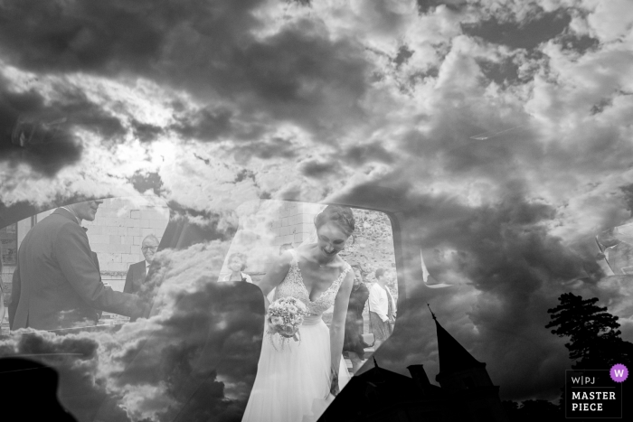 Domaine des Lys wedding day documentary style photography - Reflexion over a car