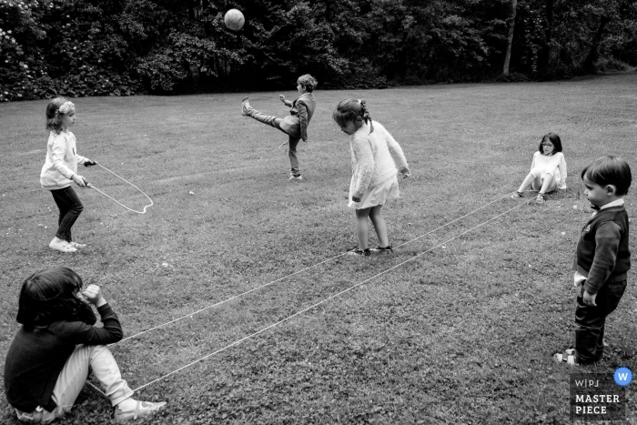 Domaine des Forges wedding photojournalism | Children playing during reception