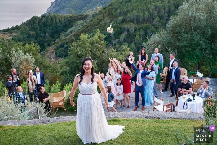 Eremo della Maddalena, Cinque Terre outdoor wedding photo during the bouquet toss