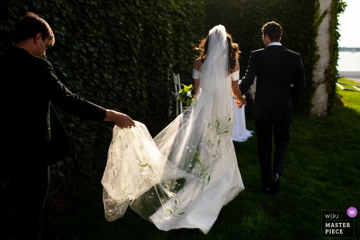 Belle Mer Wedding Venue Photography - Bride and groom get wedding planner help after a Newport, RI ceremony