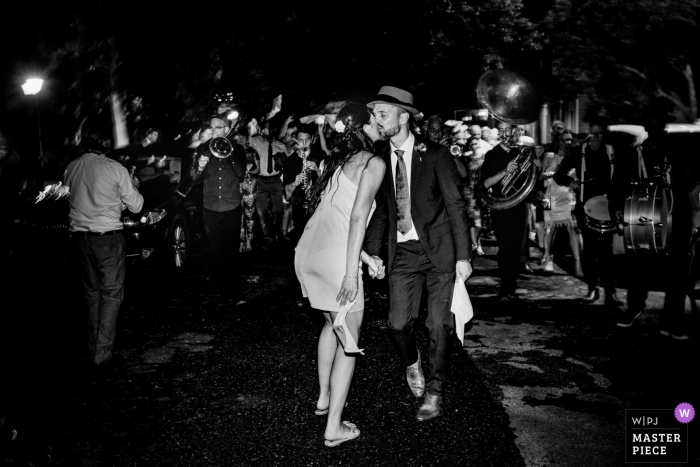 Wedding photos at the Urbania House New Orleans - Night photography of bride and groom leading the second line