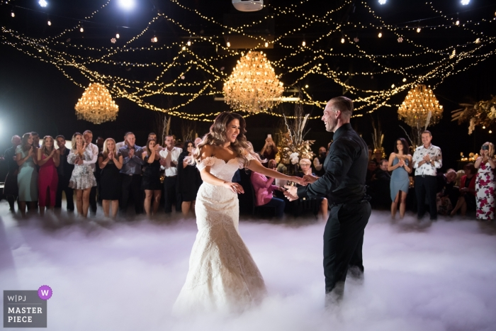 Melbourne First dance photography from the foggy wedding reception dance floor.