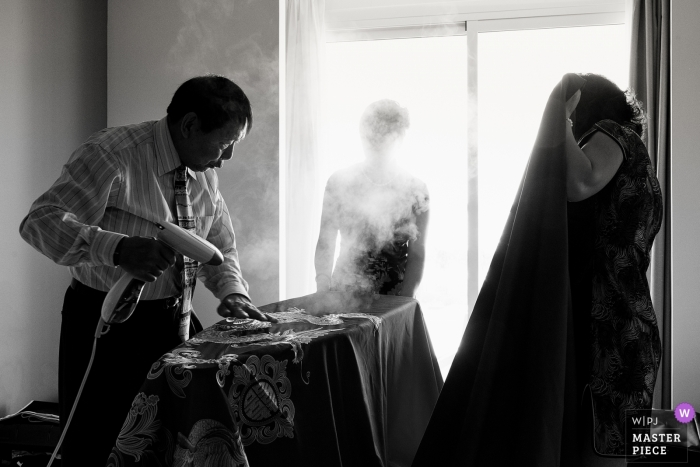 Riu Palace Costa Mujeres Hotel Wedding Day Photography of Getting ready with steam gun and dress
