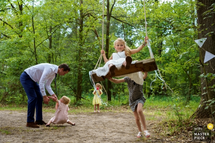 De Lutte, Jan Wesselinkhoes wedding day photography in the trees with the kids | Watch out for the swing!