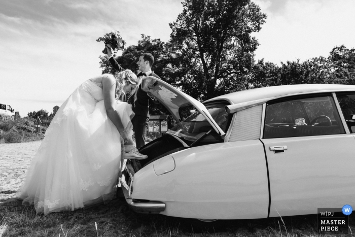 Wedding Photographer at Bord de Loire with bridal car   Image of the changing of shoes after the ceremony for the bride