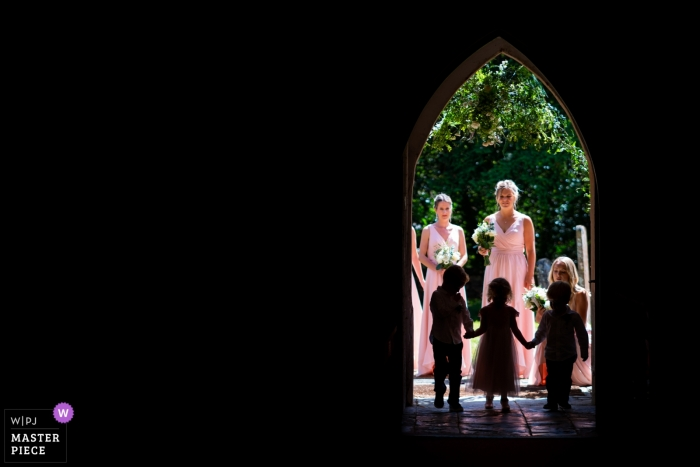 Park Farm, Daventry Wedding Photography | Page boys and a flower girl walk into church.
