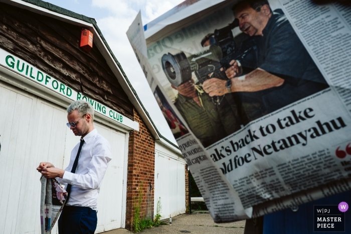 Photography at The Weyside, Guildford - Wedding guests playing newspaper games during the reception