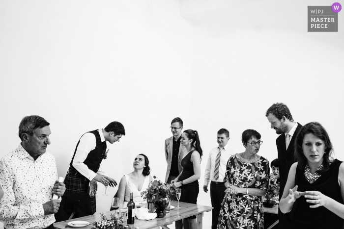 Manchester wedding photographer | Image of the bride and groom with guests after the wedding breakfast