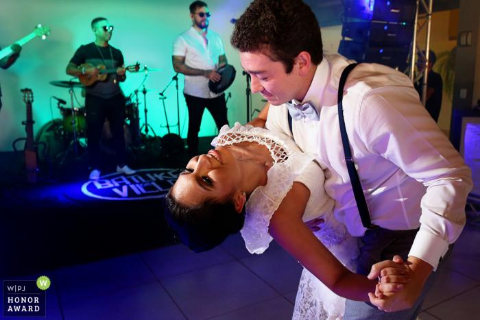 Recanto São Bento wedding venue photo from the dance floor   Groom dipping bride before the live band