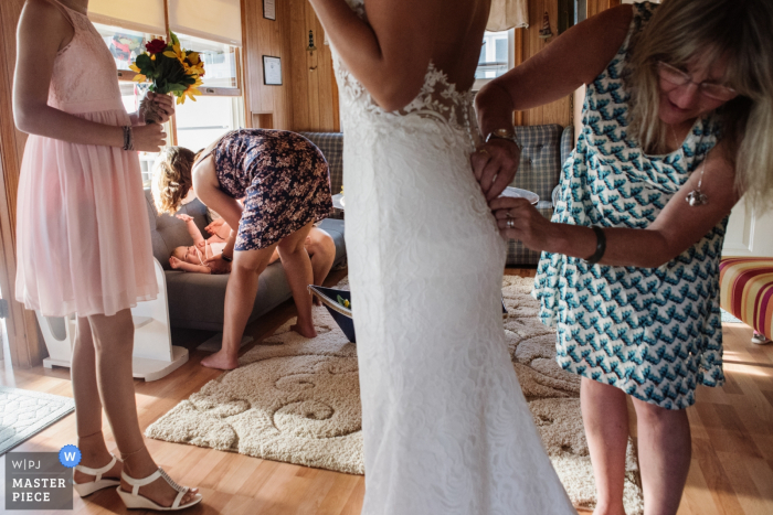 Sea Breeze New Jersey getting ready wedding photography showing bride's dress buttoned