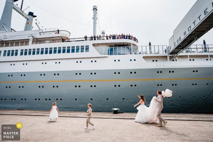 Netherlands Wedding Photography - Image contains: bride, groom, flower girl, boy, cruise ship