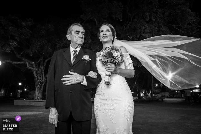 Brazil Wedding Ceremony Image of the Bride with Veil Flowing - Black and White Photography