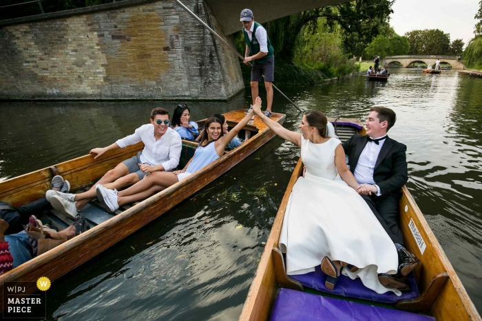 Cambridge, United Kingdom Wedding Photographer - Bride giving a high five on a punt