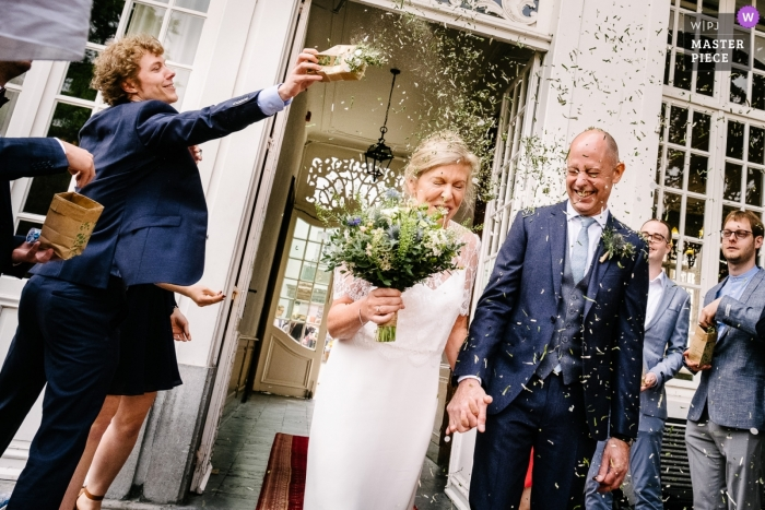 Flanders Wedding Ceremony Photo of Couple exiting townhouse