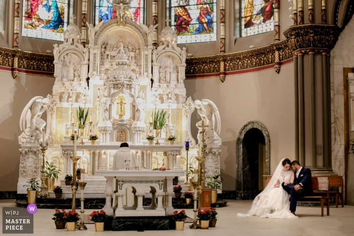 Ceremony Photography from the Wedding at St. Vincent de Paul church, Chicago. Bride and groom in the church