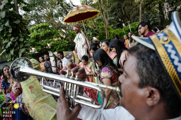 Mumbai, India Baraat procession photos on wedding day of the groom with crowd and musicians