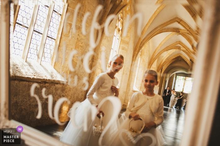 Dominikanski monastery Slovenia Wedding Photographer - The shoot was taken in the mirror while, the wedding planer helping the bride walking
