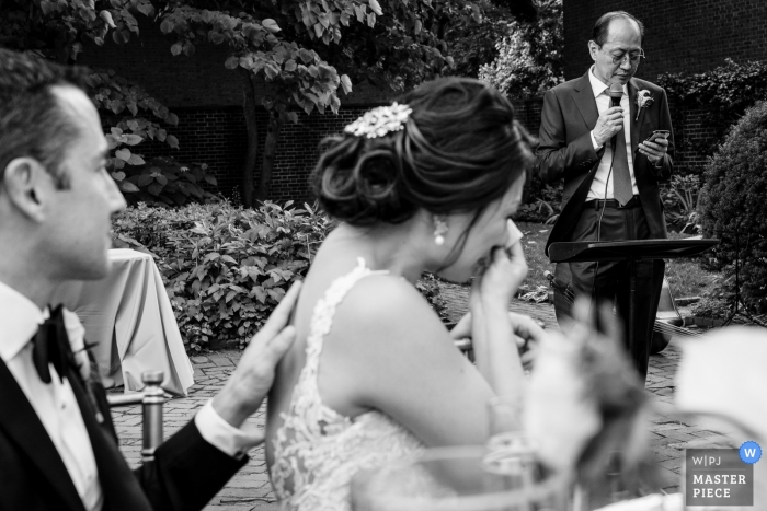 NJ Reception Venue Photography | Bride crying as the Groom comforts her during her father's welcome toast