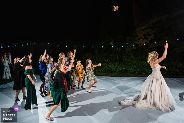 New Jersey Bride tosses her bouquette on the dance floor during the wedding reception