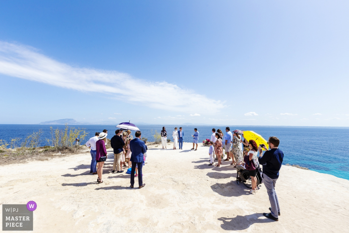 Symbolic ceremony photography at Bue Marino in Favignana Island - In front of the sea for the exchange of promises for the destination wedding in Favignana from Australia