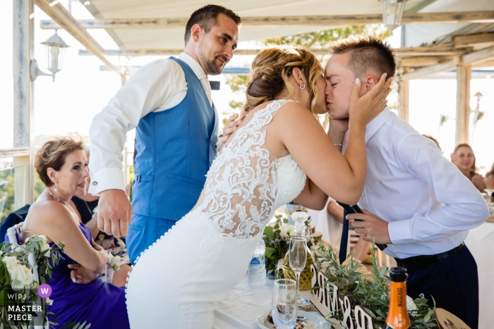 Wedding Photography at Zakynthos   A kiss after speech at the dinner