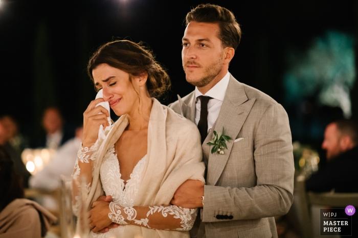 Wedding Photos from Conti di San Bonifacio Wine Resort, Tuscany | Bride crying tears, groom holding her