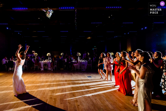 The Brewery, London, UK Wedding Venue - Photography of The Bride tossing her bouquet on the reception dance floor