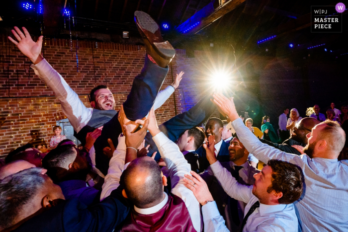 The Brewery, London, UK Wedding Venue Photos | Groom during Greek dancing at the reception.