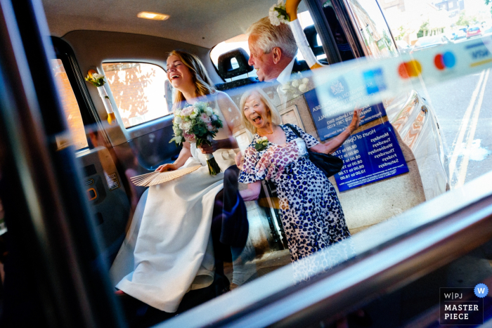 Chelsea Old Town Hall, London, UK Wedding Photography | Bride and Father are greeted by her Mother at Chelsea Old Town Hall