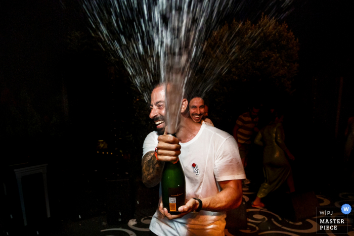 Bodrum, Macakizi Villas Wedding Venue Photography | Sparkling wine time for the groom at the reception